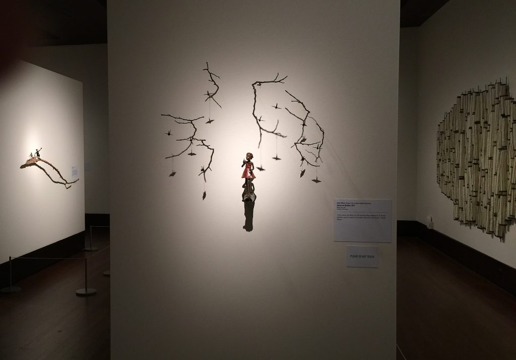 "Back Left: ""Rider"" Center: ""Secrets are Burdens"" both by Holly Wilson. Back Right: ""Reformed Order"" by Brenda Mallory. At the Exhibition Conversations: Eiteljorg Museum 2015 Contemporary Art Fellowship."